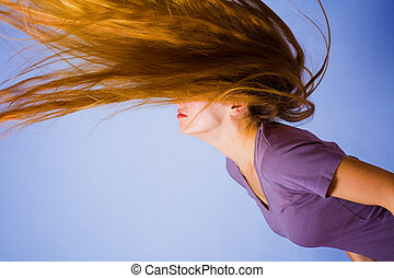 Active blond woman with long hair in motion