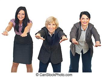 Active businesswomen doing exercises