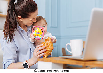 Active charismatic woman enjoying her branch with her daughter