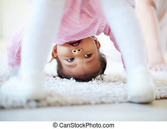 Active child - Active little girl somersaulting