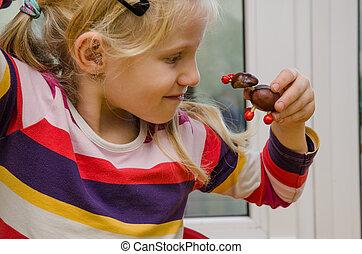 active child with autumn craft