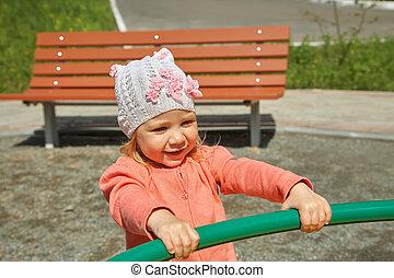little girl on playground