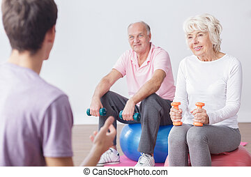 Active elderly couple and instructor