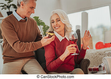 Active elderly couple celebrating Saint Valentines Day