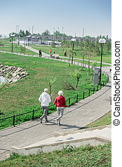 Active Elderly Couple Running Outdoors