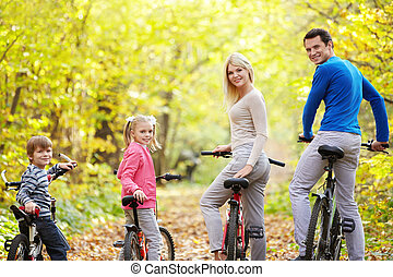 Active family - Family on bikes in the park in autumn