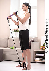 Active girl at home. Side view of confident young women in ...