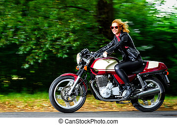 Active girl riding on the motorbike, slow motion, having fun...