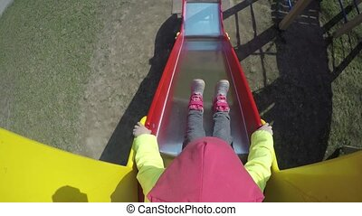 Active Girl Slide Down On Outdoor Playground