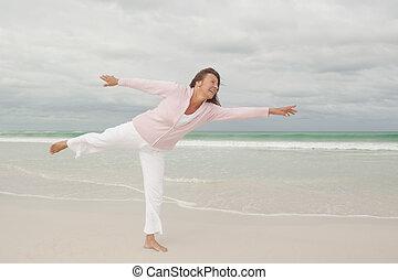 Active happy senior woman beach isolated