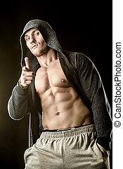active healthy lifestyle - Handsome athletic man in hoodie...