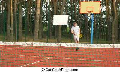 Active healthy lifestyle man playing tennis outdoors