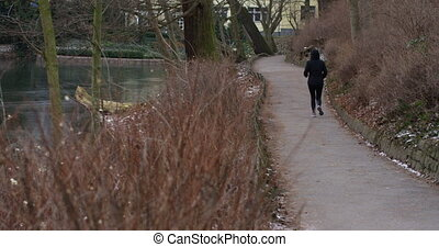 Active healthy woman doing her daily exercise run in a residential area.