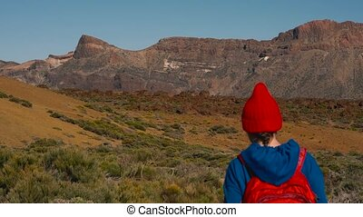 Active hiker woman hiking on Teide National Park. Caucasian...