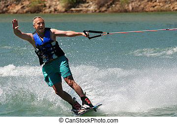 Active living - Middleage man wakeboarding