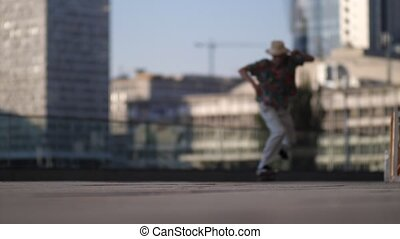Active male skater running and jumping on board - Skillful...