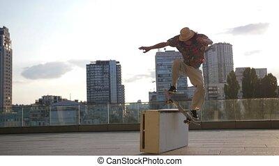 Active man skateboarder skating on ledge in city - Skillful...
