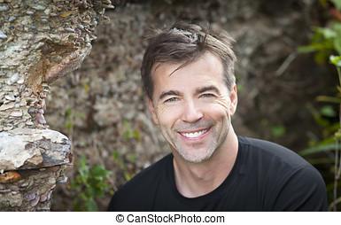 Active Man Smiling At The Camera