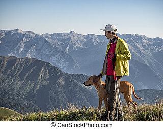 Active man with hound dog