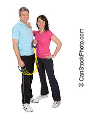 Active mature couple doing fitness