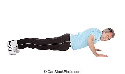 Active mature man doing pushups. Isolated on white