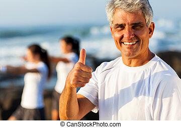 mature man giving thumb up - active mature man giving thumb...