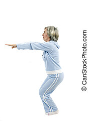 Active mature sportswoman doing some exercise for a healthy ...