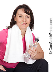 Active mature woman doing fitness