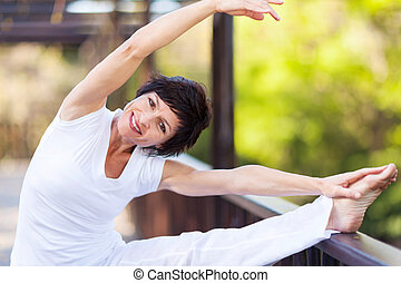 active middle aged woman stretching