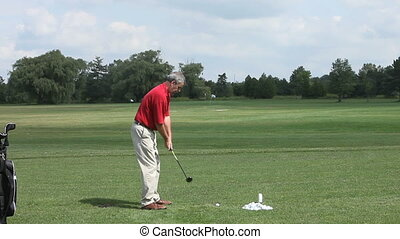 Experienced man practicing golf