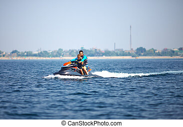 active people riding on watercraft. summer fun