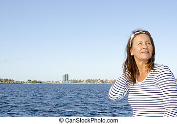 Active retired beautiful woman water background