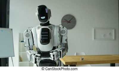 Active robotic machine dancing in office - Love this song....