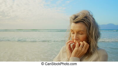 Active senior Caucasian woman standing with eyes closed on ...