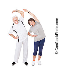Active Senior Couple Doing Fitness