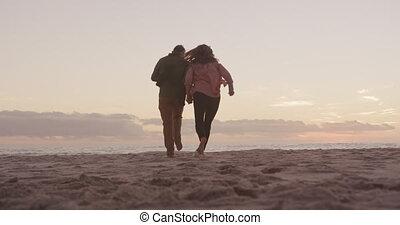 Active senior couple on beach