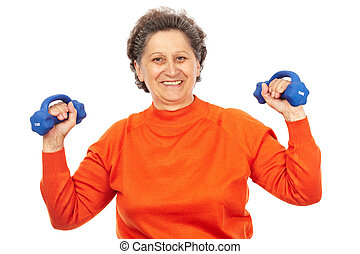 Active senior lady doing fitness - Active senior woman with...