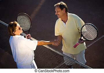 Active senior tennis partners - Active senior couple is...