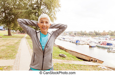 Active Senior Woman Doing Fitness Exercise