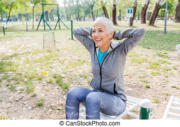 Active Senior Woman Exercise At Outdoor Gym