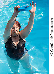 Active senior woman exercising in a swimming pool