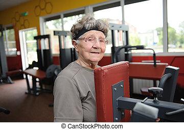 Active senior woman exercising