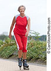 Active senior woman skating