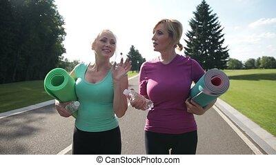 Active senior women going to train outdoors - Joyful fitness...