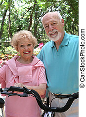 Active Seniors - A happy, active senior couple going for a...