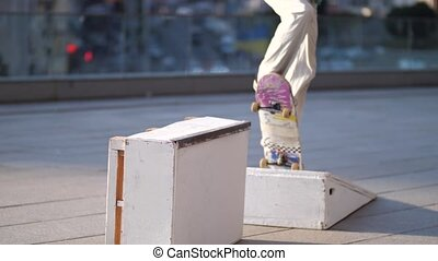 Active skateboarder sliding on ledge outdoors - Young man...