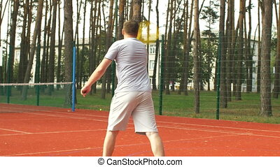 Active sporty man scoring point during tennis game