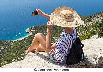 Active sporty woman on summer vacations taking selfie ...