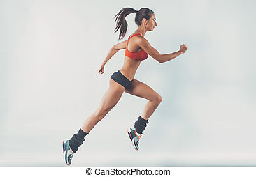 Active sporty young running woman runner athlete with copy space side view concept sport health fitness loss weight cardio training jog workout wellness.