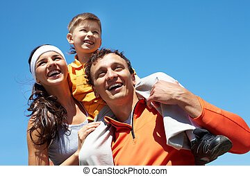 Active summer - Laughing family being excited about sporting...